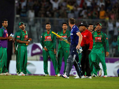 Bangladesh players exchange words with England's Jos Buttler after he was bowled out during the second ODI. Reuters