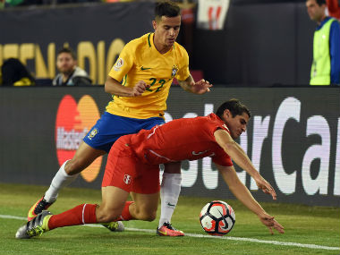 File photo of Brazil's Philippe Coutinho (L). AFP