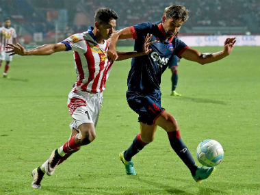 Delhi Dynamos and ATK players vie for the ball during their match in Kolkata on Saturday. PTI
