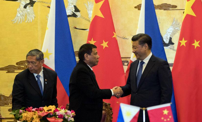 Chinese President Xi Jinping and Philippines President Rodrigo Duterte. AP