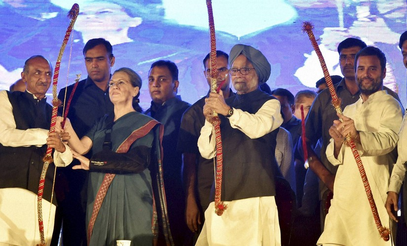 Congress president Sonia Gandhi, former PM Manmohan Singh and Congress vice-president Rahul Gandhi holding bows and arrows during Dussehra celebrations of Nav Shri Dharmic Leela Committee at Red Fort Ground in New Delhi. PTI