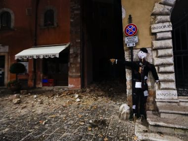 A Halloween dummy rests on a wall in the town of Visso in central Italy after a 5.9 earthquake hit the area early on Thursday. AP