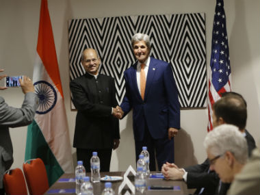 Secretary of State John Kerry, centre-right, shakes hands with India's Minister of Environment, Forest and Climate Change Shri Anil Madhav Dave. AP