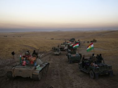 A Peshmerga convoy drives towards a frontline in Khazer, about 30 km east of Mosul, Iraq on  Monday. AP