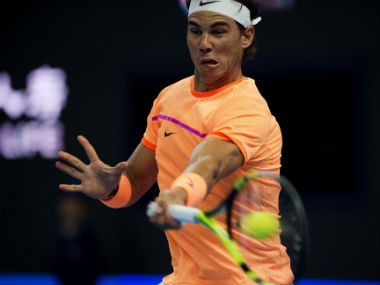 Rafael Nadal hits a return to Paolo Lorenzi during the first round of the China Open. AFP