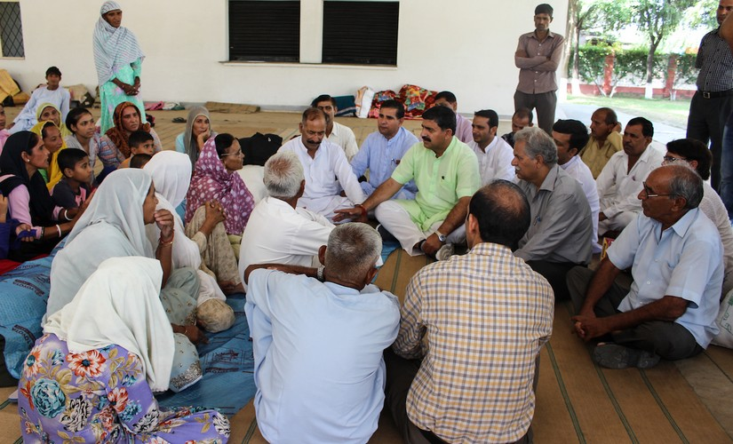 BJP MP Jugal Kishore Sharma interacting with villagers insdie a camp in Khour, Jammu. Photo credit : Sameer Yasir