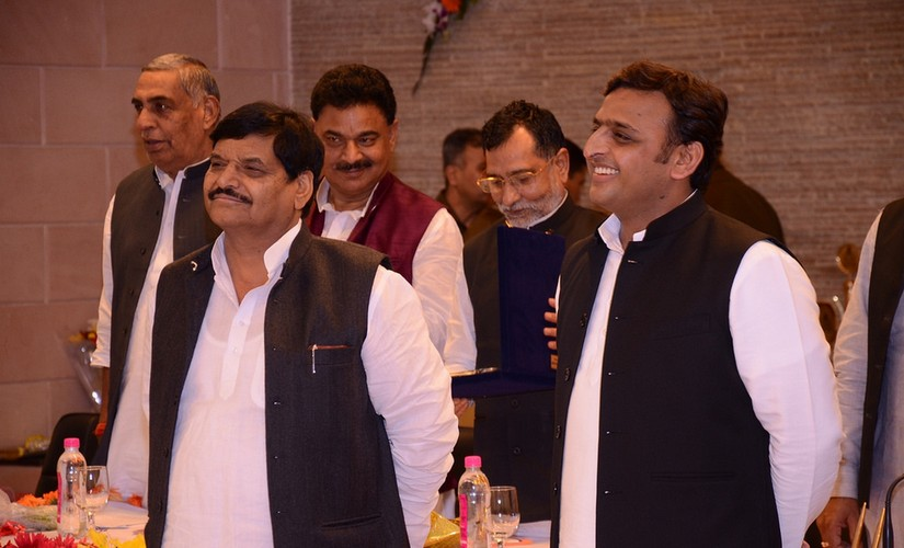 UP chief minster Akhilesh Yadav (R) with Uncle Shivpal Yadav (l). PTI