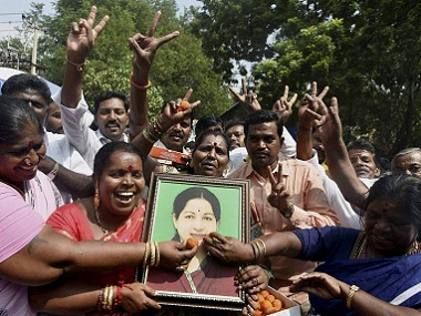 AIADMK cadres celebrate their party's victory in Tamil Nadu bypolls. PTI