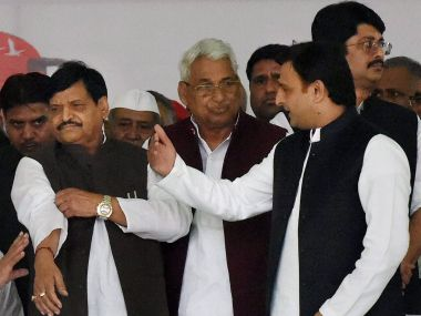 Akhilesh Yadav and Shivpal Yadav at the Samajwadi Party's rath yatra event on Thursday. PTI