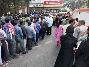 People standing in long queues to exchange their old Rs 500 and 1000 notes and withdraw cash from the ATM in New Delhi om Thursday.PTI