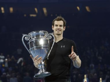 Andy Murray of Britain holds the trophy after winning the ATP World Tour Finals. AP