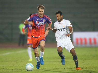 FC Pune City's Anibal passes the ball during the  match against NorthEast United. ISL