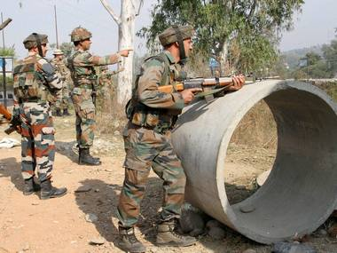 Security personnel take positions during a gun battle with suspected militants at Army camp at Nagrota. PTI