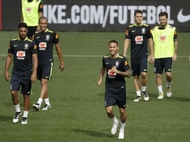 Brazil's Neymar and teammates, attend a training session in Belo Horizonte. AP