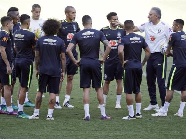 Brazil coach Tite talks with his players during a training session in Belo Horizonte. AP