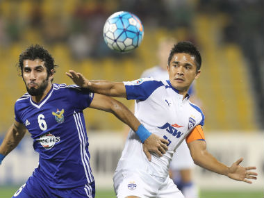 Bengaluru FC captain Sunil Chhetri vie for the ball with an Air Force Club player during the AFC Cup final. AFP