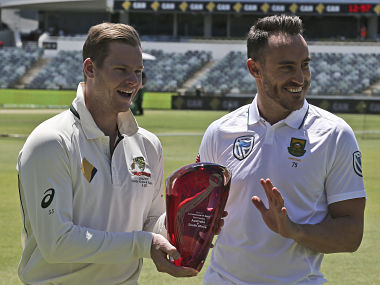 Australia's Steve Smith captain and South Africa's captain Faf du Plessis laugh about touching the series trophy in Perth ahead of the first Test. AP