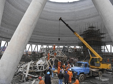 Rescue workers look for survivors after a work platform collapsed in China's Jiangxi Province. AP