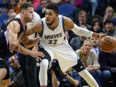 Los Angeles Clippers forward Blake Griffin defends Minnesota Timberwolves center Karl-Anthony Towns. AP