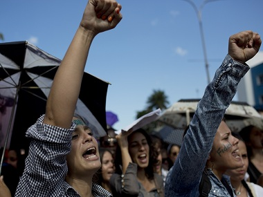University students chants slogans in honor of the late Fidel Castro in Havana, Cuba, Monday, Nov. 28, 2016. Tribute sites are set up in hundreds of places across the country to farewell Castro, who died late Nov. 25. (AP Photo/Rodrigo Abd)