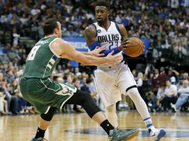 Milwaukee Bucks center Miles Plumlee defends Dallas Mavericks guard Wesley Matthews. AP