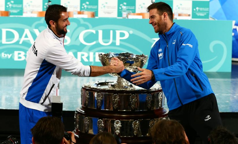 Croatia's Marin Cilic and Argentina's Juan Martin del Potro pose for a picture after the official draw for their Davis Cup final. Reuters