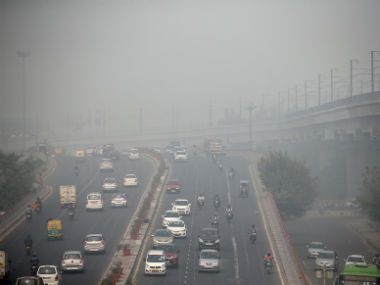 Traffic driving through smog in Delhi. Reuters