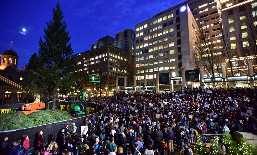 Protesters gather in Pioneer Courthouse Square in Portland, Oregon on the third night of protests over the results of the 2016 US presidential election. AP