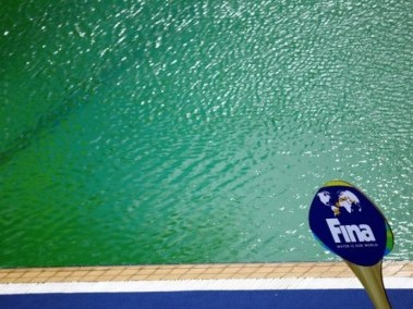 An International Swimming Federation (FINA) sign is seen in front of the Aquatics Centre pool in Rio where the water turned green. Reuters
