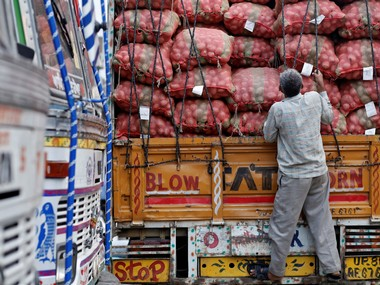 A labourer prepares to unload sacks of potatoes from a truck at a wholesale vegetable and fruit market in New Delhi 2 July, 2014. Reuters
