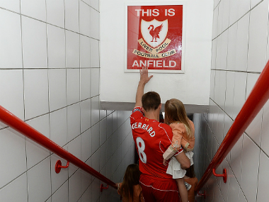 Steven Gerrard touches the Anfield sign one last time before walking out onto the pitch. Getty images