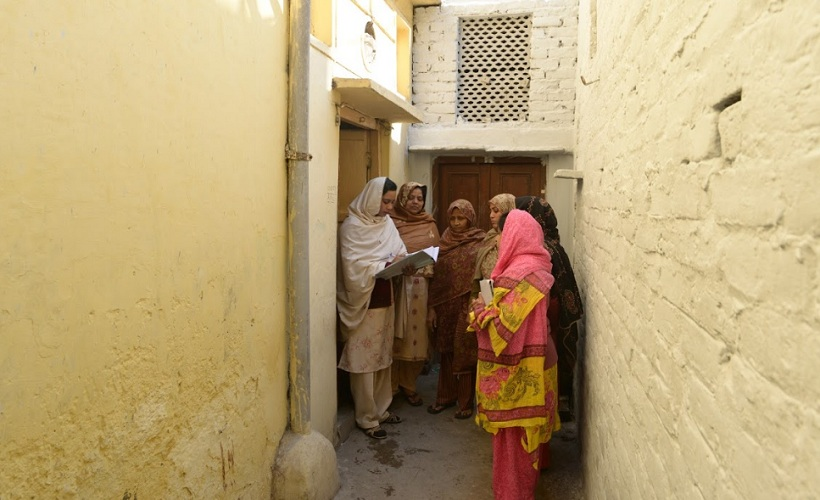 "Sehat Saheli Meherunissa, doing a door to door visit. ""Women around this area didn't know anything about their health. They could not even talk about their menstruation cycle. Initially they didn't even want to talk to us, men used to say these AKTC people are bad, don't let them talk to our women. But today they depend upon us, trust us. It feels great to be part of this change,"" Said Meherunissa. Photo AKTC"