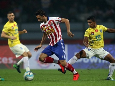 Helder Postiga of Atletico de Kolkata tackles the ball past the Kerala Blasters players. ISL