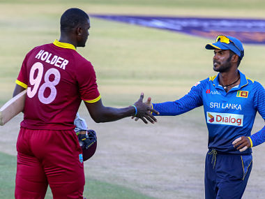 Sri Lanka captain Upul Tharanga(R) shakes hands with West Indies' Jason Holder after the win. AFP