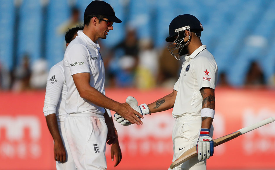 India survived a jittery final session Sunday, reaching 172-6 in 52.3 overs on the fifth day, to secure a draw in the first test against England. Indian captain Virat Kohl, right, shakes hand with England's cricket captain Alastair Cook at the end of the fifth day. AP