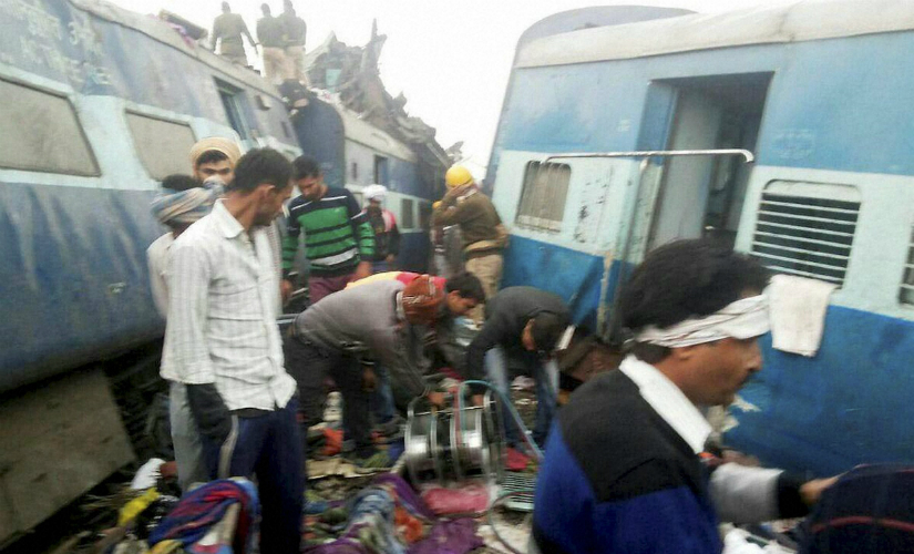 Rescue officials on the spot where 14 coaches of the Indore-Patna express derailed, killing around 96 people and injuring 200, in Kanpur Dehat on Sunday. PTI