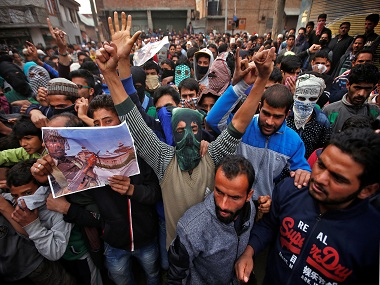 Demonstrators shout slogans during an anti-India protest in Srinagar. Reuters
