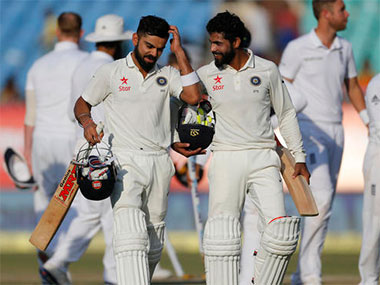 Virat Kohli walks back with Ravindra Jadeja at the end of the fifth day of the Rajkot Test against England. AP