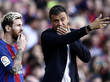 FC Barcelona's Lionel Messi talks with his coach Luis Enrique. AP