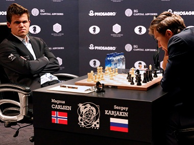 Magnus Carlsen and Sergey Karjakin in action during the first match of the World Chess Championship. Reuters