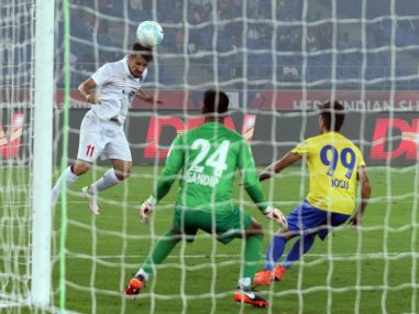 Marcelo Leite Pereira of Delhi Dynamos FC heads the ball for goal against Kerala Blasters. ISL