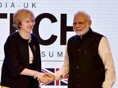 Prime Minister Narendra Modi shakes hands with UK counterpart Theresa May at the inauguration of India- UK Tech Summit, in New Delhi. PTI