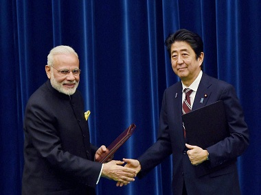 Prime Minister Narendra Modi with his Japanese counterpart Shinzo Abe. PTI