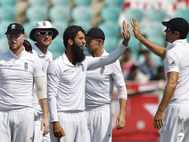 Moeen Ali celebrates with teammates the dismissal of Ravindra Jadeja on Day 2. AP