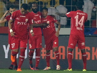 NorthEast United FC players celebrate a goal against FC Goa. ISL