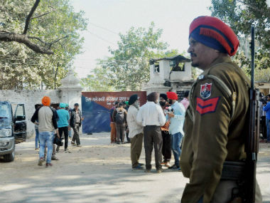 Security personnel and media outside Nabha Central Jail, which was stormed by armed men. PTI