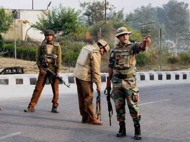 Security personnel take positions during a gun battle with suspected militants at the Army camp in Nagrota in Jammu on Tuesday. PTI