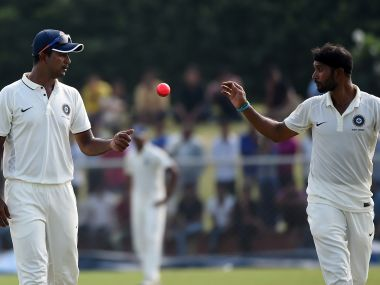 Pragyan Ojha (Left) and Ashok Dinda were involved in a feud ahead of West Bengal-Tamil Nadu match. AFP
