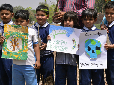 Children protest against alarmingly rising pollution in Delhi. AFP
