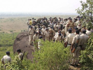 Police investigate the encounter site in Bhopal. PTI